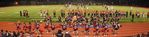 Cheerleaders cheering during a football game